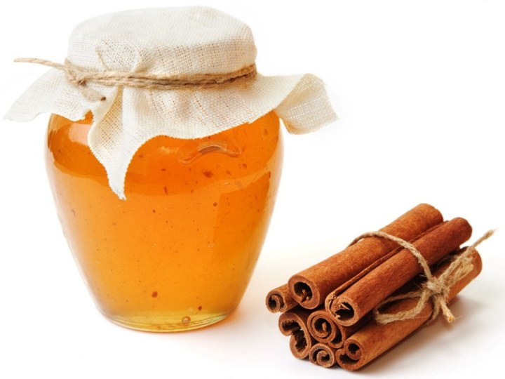 An Image of Sweet Honey in Jar with Cinnamon