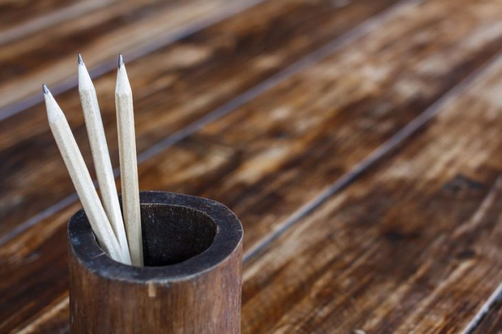 Pencil in bamboo on wood table background