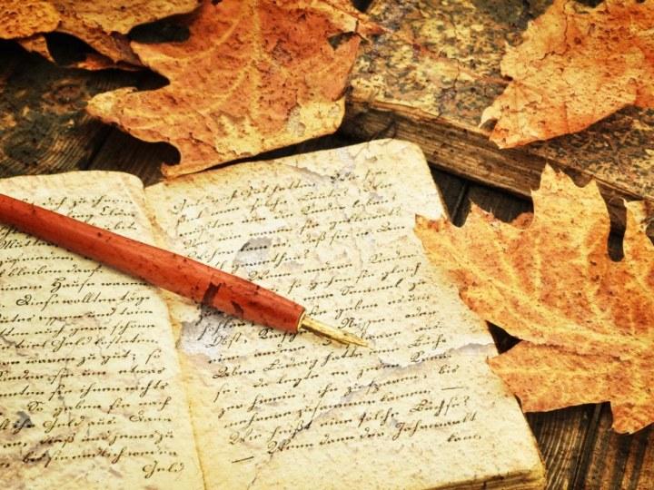Fountain Pen on Old Handwritten Book