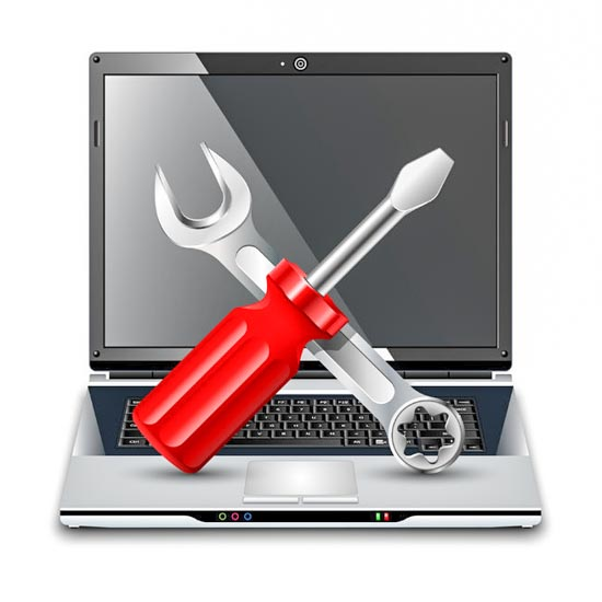 Laptop with screwdriver and wrench